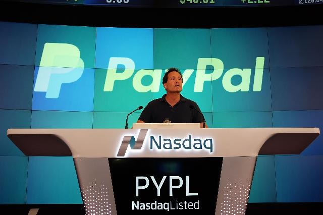 PayPal CEO Dan Schulman celebrating his company's listing on the Nasdaq