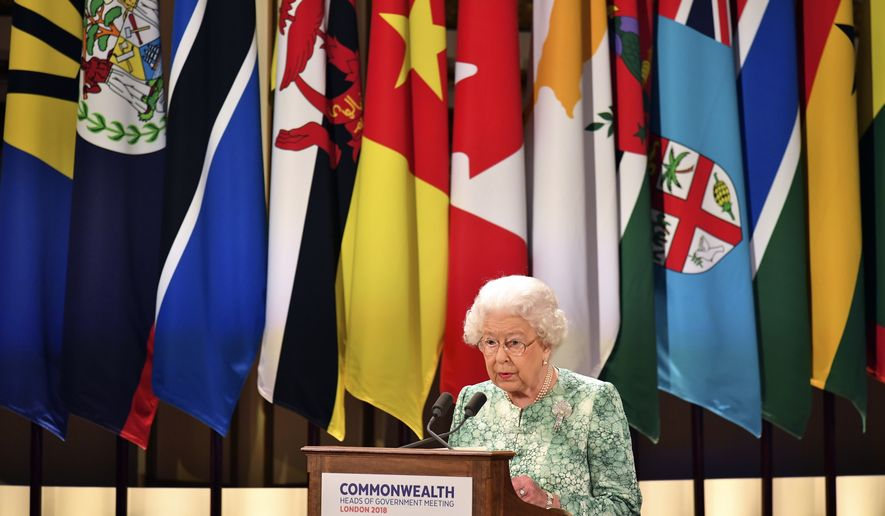 Britain's Queen Elizabeth II speaks during the formal opening of the Commonwealth Heads of Government Meeting in the ballroom at Buckingham Palace in London, Thursday April 19, 2018.