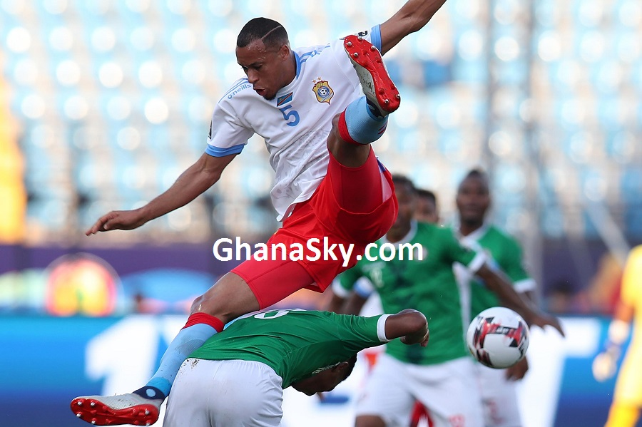 Marcel Tisserand of DR Congo fouled by Lalaina Henintsoa Enjanahary of Madagascar during the 2019 Africa Cup of Nations