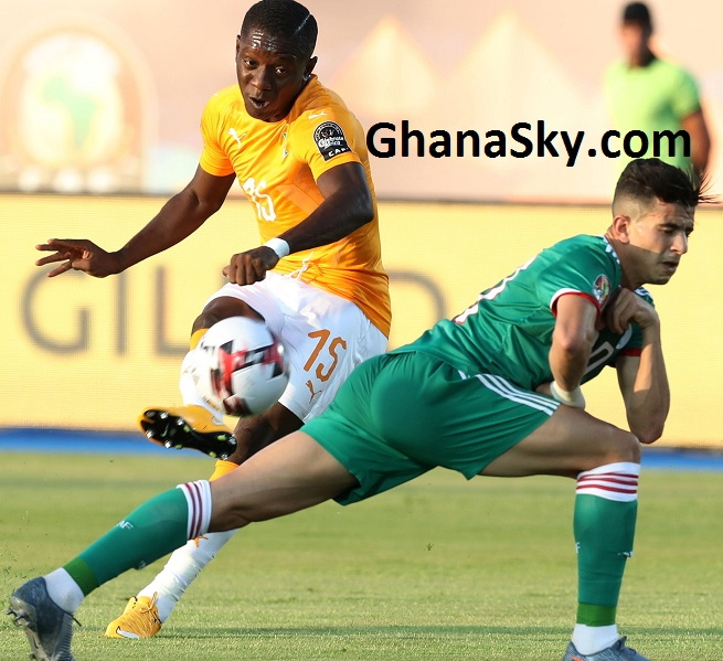 Max Gradel of Ivory Coast challenged by Youcef Atal of Algeria during the 2019 Africa Cup of Nations Finals, quarterfinals match between Ivory Coast and Algeria at Suez Stadium, Suez, Egypt.